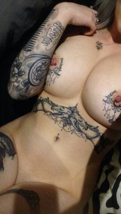 tatoos on a woman titts